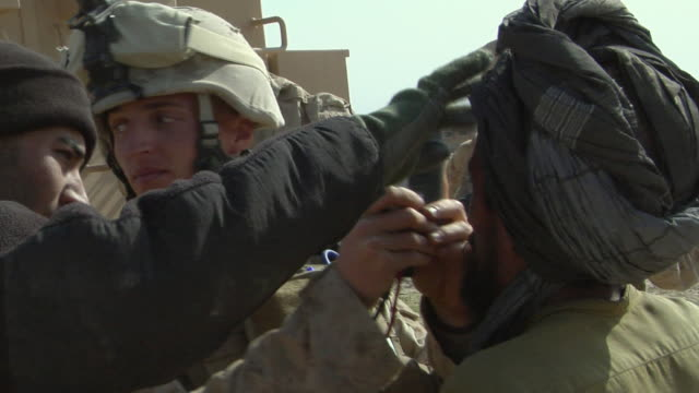 february 2009 cu view of solider using eye scanner for civilian identification / bakwa farah province afghanistan - detainee stock videos & royalty-free footage