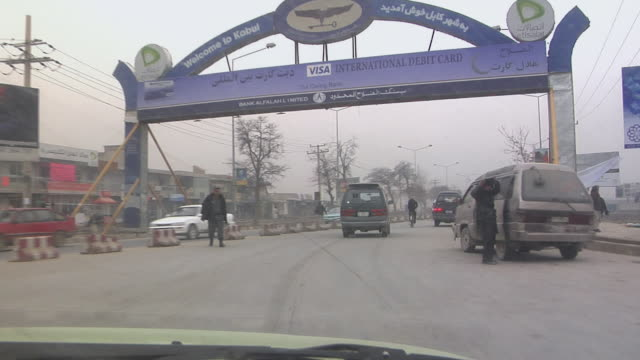 february 2009 ws pov view of traffic on street / kabul afghanistan - kabul stock videos and b-roll footage