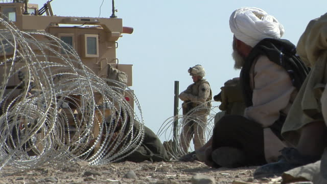february 2009 workers making barbed wire fence / bakwa, farah province, afghanistan - barbed wire stock videos & royalty-free footage