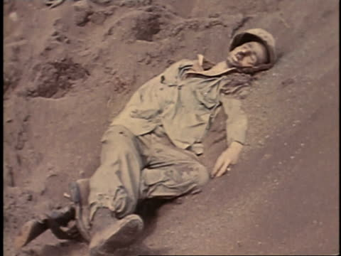 february 23 1945 montage bodies of dead soldiers / iwo jima japan - schlacht um iwojima stock-videos und b-roll-filmmaterial