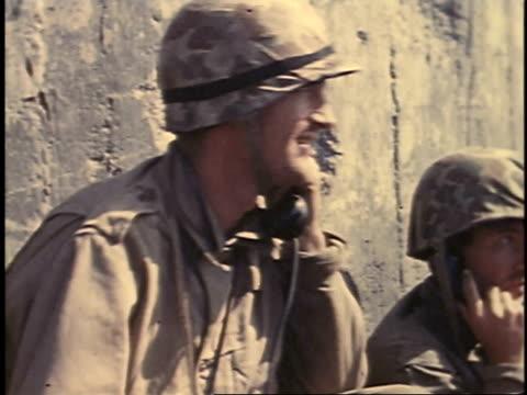 february 23, 1945 montage soldiers talking on phone, looking at map / iwo jima, japan - battaglia di iwo jima video stock e b–roll