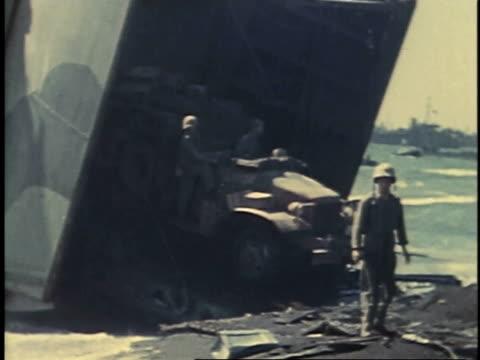 february 23, 1945 montage supply truck driving off a ship / iwo jima, japan - battaglia di iwo jima video stock e b–roll