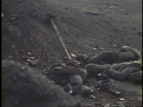 february 24 1945 montage injured soldiers laying on the ground while other soldiers run around and help them / imo jima japan - schlacht um iwojima stock-videos und b-roll-filmmaterial