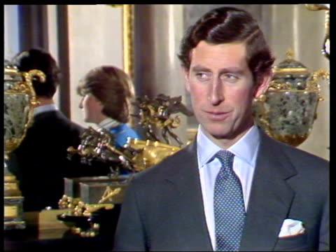 vídeos de stock e filmes b-roll de february 24, 1981 prince charles and lady diana talking to the press shortly after announcing their engagement/ charles talking/ diana/ charles and... - 1981
