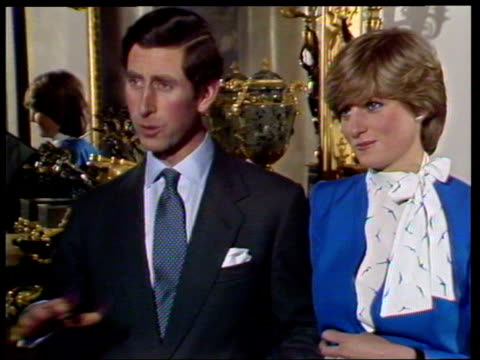 vídeos de stock e filmes b-roll de february 24, 1981 prince charles and lady diana talking to the press shortly after announcing their engagement/ charles and diana holding hands/... - 1981