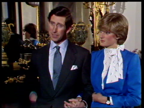 vídeos de stock e filmes b-roll de february 24, 1981 prince charles and lady diana talking to the press shortly after announcing their engagement/ sapphire and diamond engagement ring... - 1981