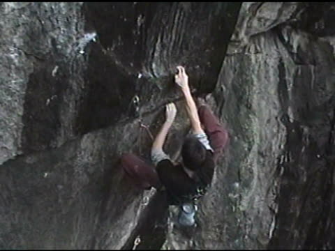 february 25 2009 ts a climber traditional climbing the face of a sheer rock wall - krab stock videos & royalty-free footage