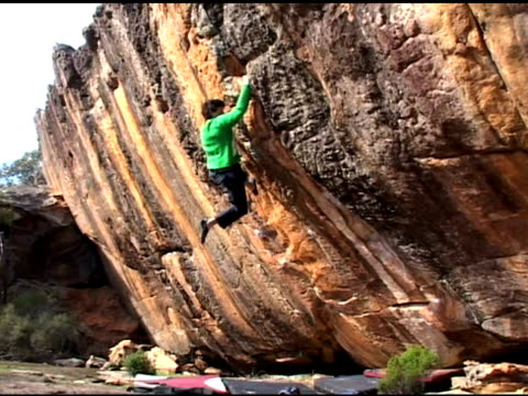 february 25, 2009 montage a climber free solo climbing the face of a rock wall - free climbing stock videos & royalty-free footage