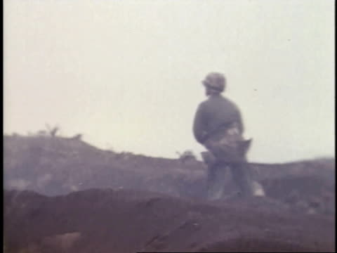 february 26 1945 montage soldier throwing grenades / iwo jima japan - battle of iwo jima stock videos and b-roll footage