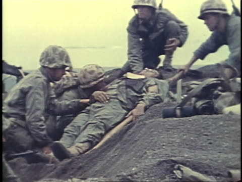 february 26, 1945 montage soldiers carrying wounded man on a stretcher / iwo jima, japan - battle of iwo jima stock videos & royalty-free footage