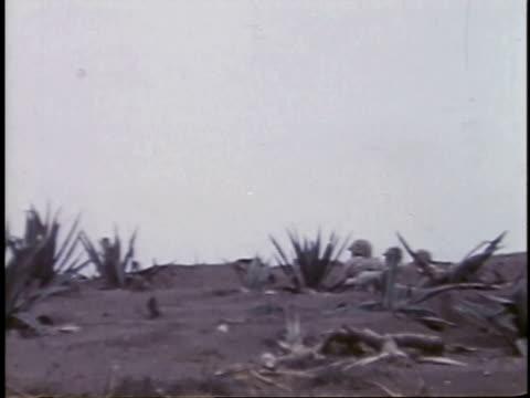 february 26, 1945 soldier throwing grenade / iwo jima, japan - battaglia di iwo jima video stock e b–roll
