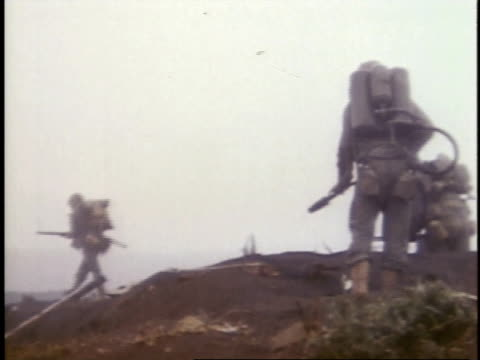 february 26, 1945 soldiers walking over dead bodies / iwo jima, japan - battaglia di iwo jima video stock e b–roll