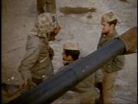 february 27, 1945 montage soldiers talking and resting / iwo jima, japan - battaglia di iwo jima video stock e b–roll