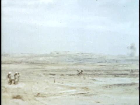 february 27, 1945 soldiers carrying wounded man on a stretcher / iwo jima, japan - battaglia di iwo jima video stock e b–roll