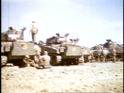 february 27 1945 ws soldiers standing near tanks / iwo jima japan - schlacht um iwojima stock-videos und b-roll-filmmaterial