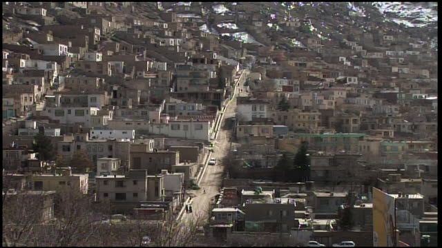 february 28, 2009 montage winter-bare tree branches overlooking residential neighborhood / kabul, afghanistan - kabul stock videos & royalty-free footage