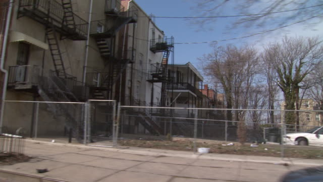 february 29 2008 ds residential neighborhood of row houses and boarded up buildings / baltimore maryland united states - 2008 stock videos & royalty-free footage
