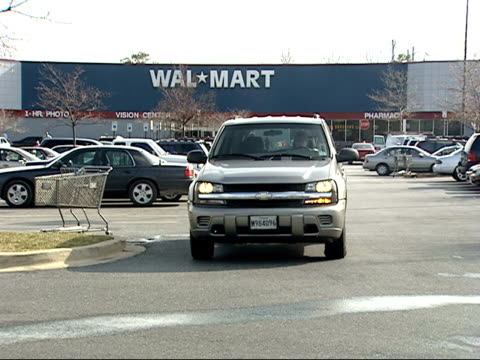 february 3, 2006 pickup turning out of wal-mart parking lot with cars driving by on street / laurel, maryland - 2000s style stock videos & royalty-free footage