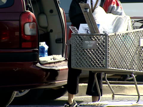 february 3 2006 cu woman unloading bags from shopping cart into her car / laurel maryland - laurel maryland stock videos & royalty-free footage