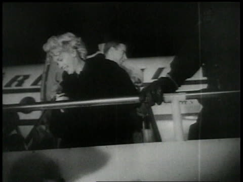 february 4, 1954 joe dimaggio and marilyn monroe are greeted after they disembark from a plane / tokyo, japan - 1954 stock videos & royalty-free footage