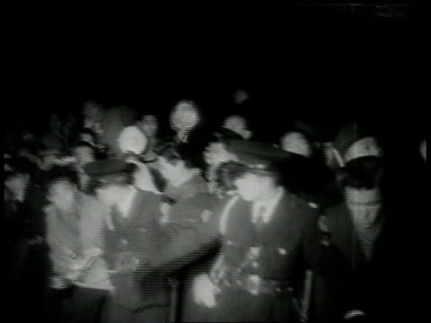 february 4, 1954 police hold back crowd as joe dimaggio and marilyn monroe exit the plane / tokyo, japan - 1954 stock videos & royalty-free footage