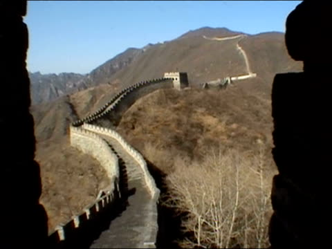 February 4, 2002 High angle view through crenellation of Great Wall of China / China