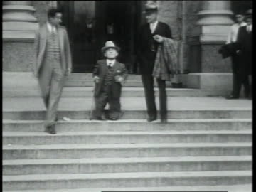 february 5, 1931 ls small man with cane walking with others out of building and shaking hands with others / austin, texas, united states - 1931 stock videos & royalty-free footage