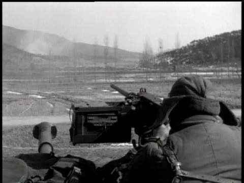 february 5, 1951 montage soldier firing a machine gun mounted on a tank / korea - 1951点の映像素材/bロール
