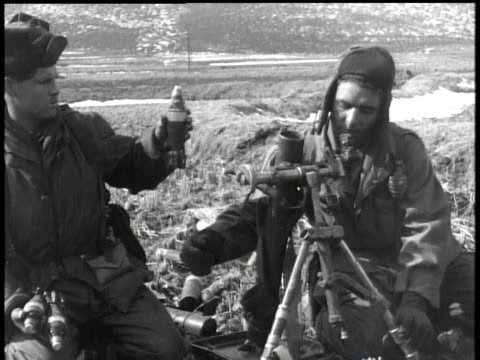 february 5, 1951 montage soldiers firing artillery / korea - anno 1951 video stock e b–roll