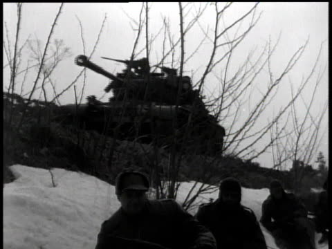 february 5, 1951 tanks passing while troops gathering in snow / korea - 1951点の映像素材/bロール