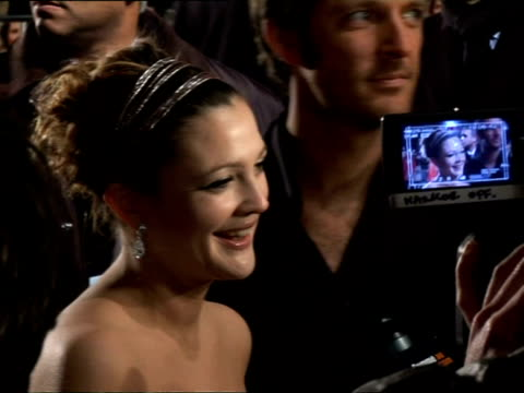 february 5, 2007 drew barrymore being interviewed at the 'music and lyrics' premiere/ london, england/ audio - hair accessory stock videos & royalty-free footage