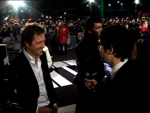 february 5, 2007 hugh grant being interviewed at the 'music and lyrics' premiere/ london, england/ audio - toothy smile stock videos & royalty-free footage