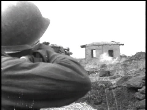 february 7, 1951 montage soldiers firing rifle at a building / korea - anno 1951 video stock e b–roll