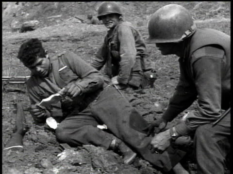 february 7, 1951 montage wounded soldier receiving medical treatment / korea - 1951点の映像素材/bロール