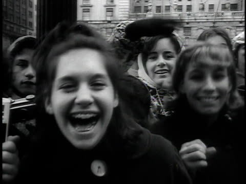 february 8, 1964 montage fans in the streets as beatles are heading to their hotel, three beatles walking in central park being photographed / new... - the beatles bildbanksvideor och videomaterial från bakom kulisserna