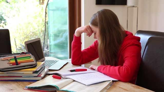 fed up teenage girl doing highschool homework at a dining table - only teenage girls stock videos & royalty-free footage