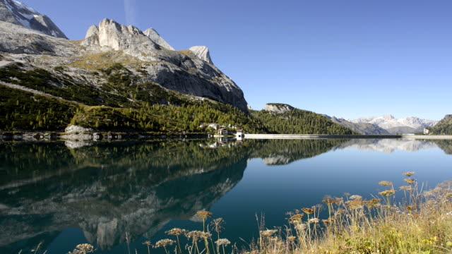 fedaia lake and marmolada mountains - val di fassa video stock e b–roll