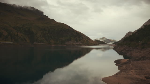 fedaia lake by the marmolada, on dolomites - val di fassa stock videos and b-roll footage