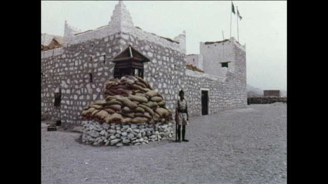 montage federal arab troops stand guard in the mountains / aden, yemen - aden stock videos & royalty-free footage