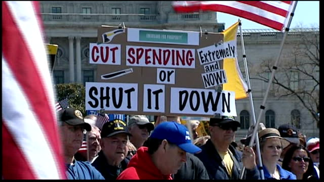 Lack of agreement threatens government shut down USA Washington EXT People demonstrating outside the Capitol Building calling for the budget deficit...