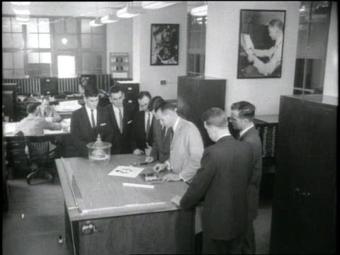 federal bureau of investigation agent demonstrates the restoration of a charred document for trainees. - fbi video stock e b–roll