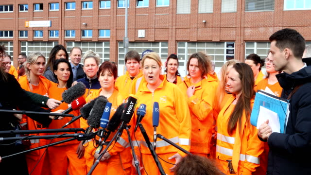 federal minister for family affairs senior citizens women and youth franziska giffey in orange workwear of the bsr speaks to the media during her... - internationaler frauentag stock-videos und b-roll-filmmaterial