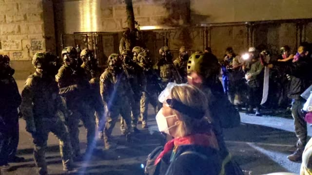 federal officers form a police line in front of the mark o. hatfield u.s. courthouse in the early hours of july 30, 2020 in portland, oregon.... - the march of time stock videos & royalty-free footage
