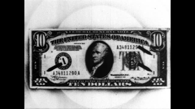 / CU of federal seal on a bank note / pointer used to indicate ledger at top of ten dollar bill / pointer used to indicate regional bank seal on ten...