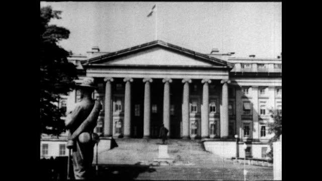 stockvideo's en b-roll-footage met / ext federal treasury building / int cu sign stating us secret service the us treasury building on january 01 1939 in washington dc - geheime dienstagent