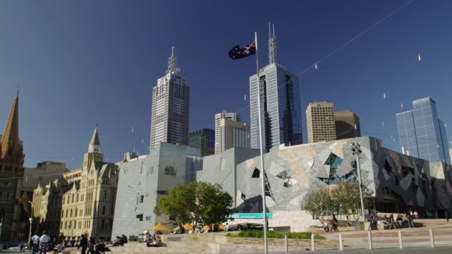 Federation Square with East Melbourne Skyline, Melbourne, Victoria, Australia