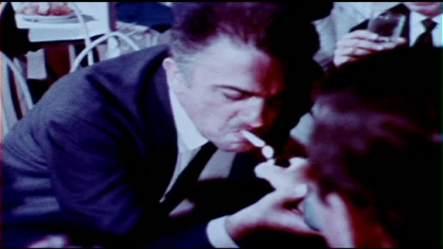 italy federico felllini leans over to light his cigarette - federico fellini stock videos & royalty-free footage