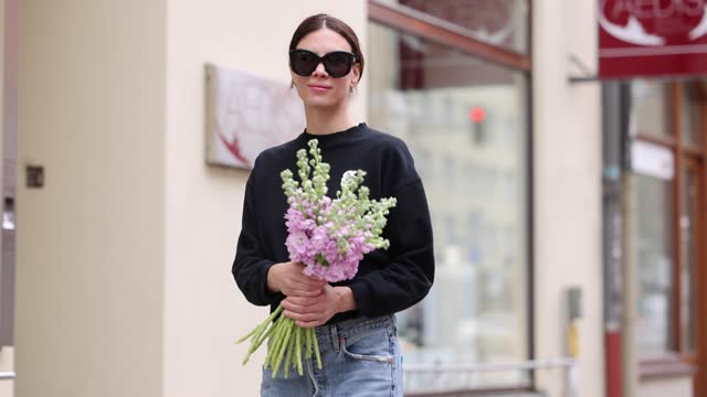 stockvideo's en b-roll-footage met federrock founder anna von schilcher wears a black sweater by glam-o-meter, light blue wide leg denim jeans by citizens of humanity, black pumps by... - breed