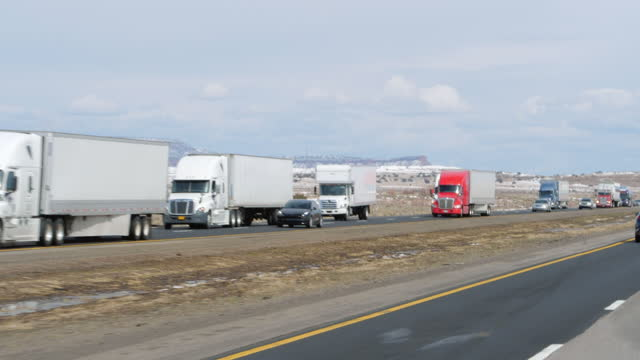 fedex trucks are seen in the interstate 40 traffic jam in arizona section amid the covid-19 pandemic. - tranquil scene stock videos & royalty-free footage