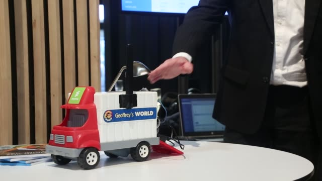 Fedor Maas solution architect at Ericsson AB left stands by a model truck while demonstrating 5G fleet and logistic remote management on an Internet...